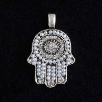 white beaded hamsa pendant